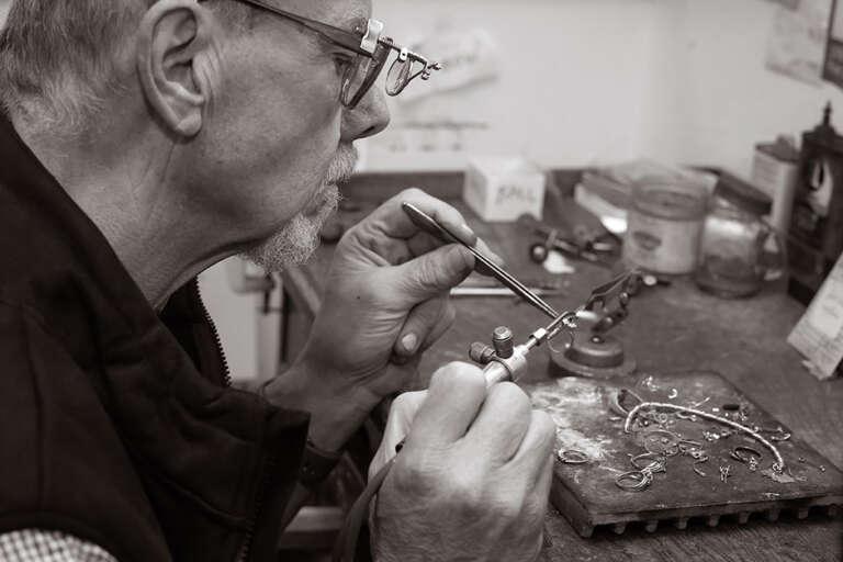 Thomas Nevin repairing jewelry